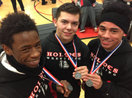 Three Holmes wrestlers qualify for state tournament