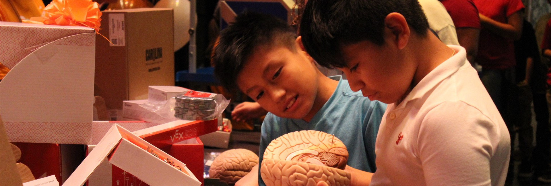 Students play with a brain model donated by Amazon.