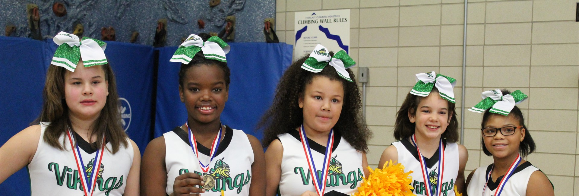 Cheerleaders from Ninth District pose for a quick picture after winning a medal at competition.