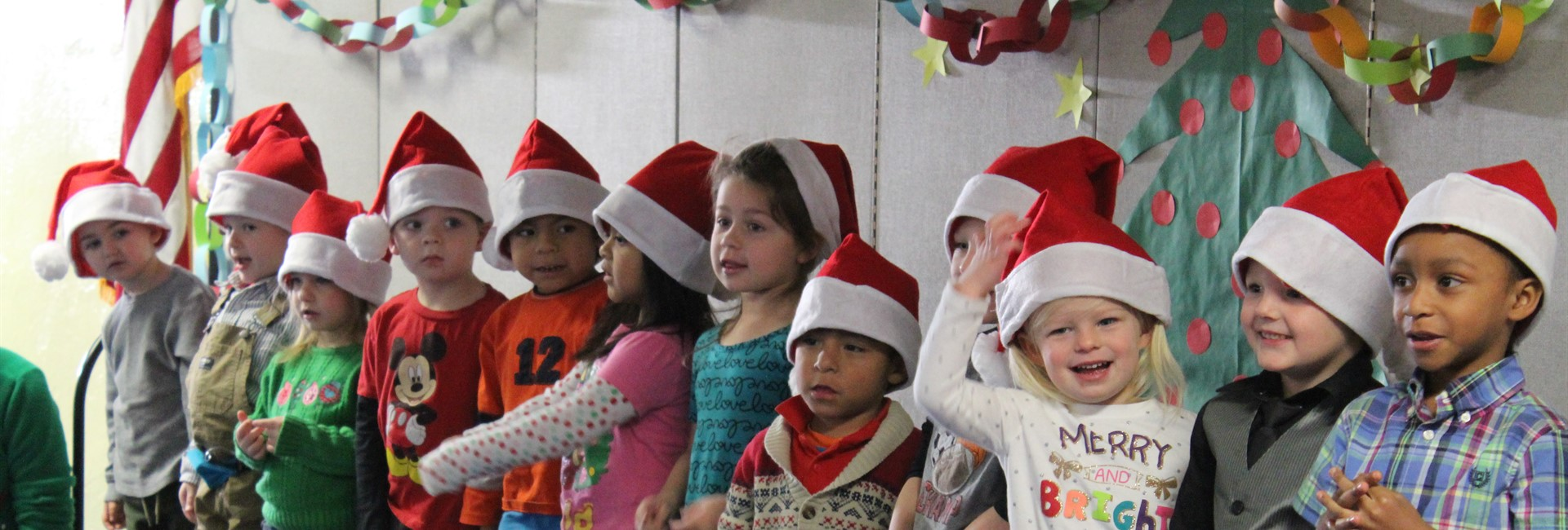 Preschoolers perform a song for the holiday program.