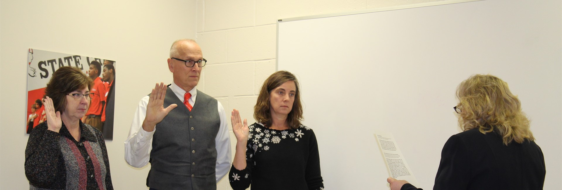 New school board members, Glenda Huff, Tom Wherry, and April Brockhoff are sworn into office.
