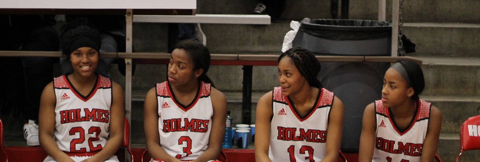 Girls basketball players taking a break from the game.