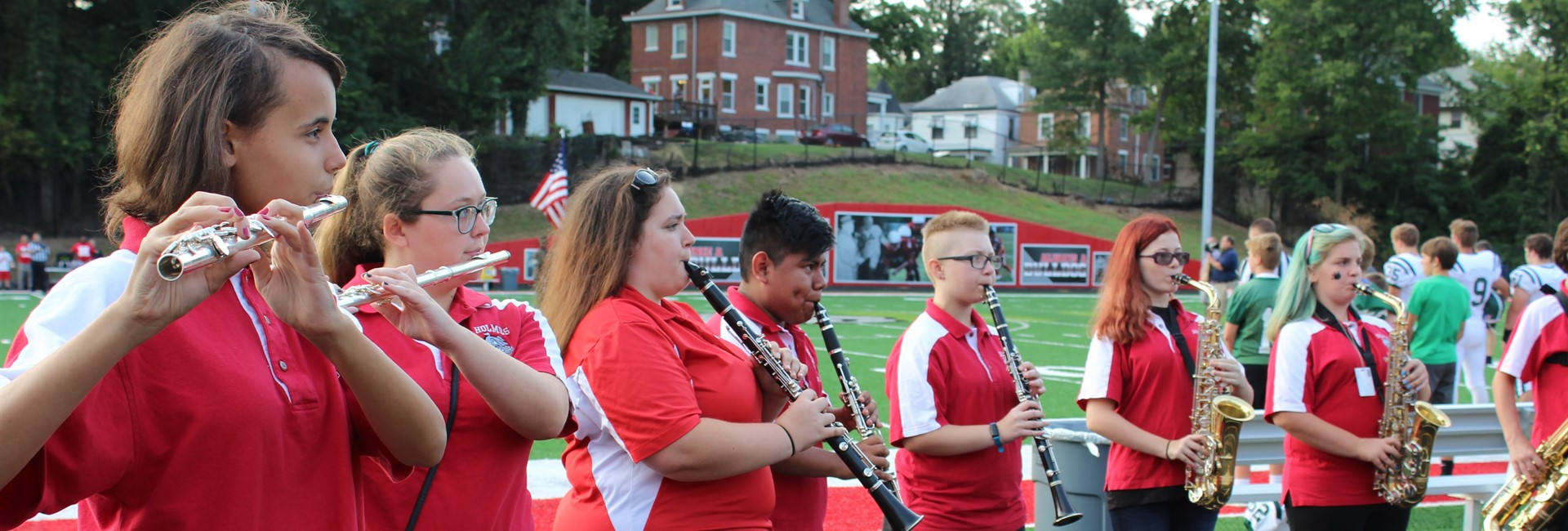 Holmes High School band plays the national anthem before the first football game.
