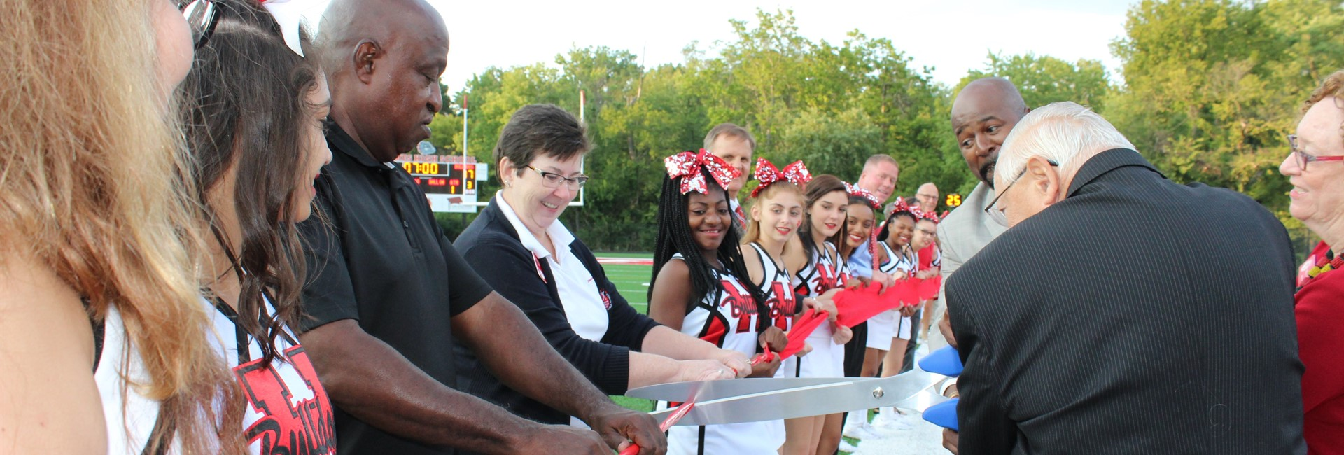 The ribbon is cut to open the new Holmes stadium.