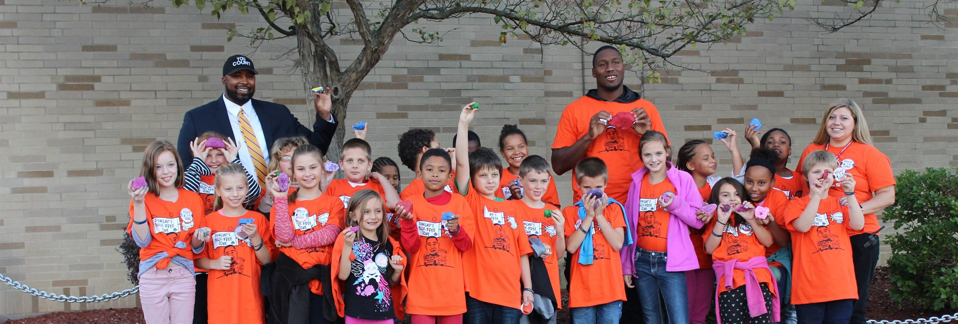Students gather with Bengals defensive end Carlos Dunlap